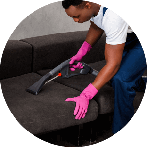 a person cleaning the sofa