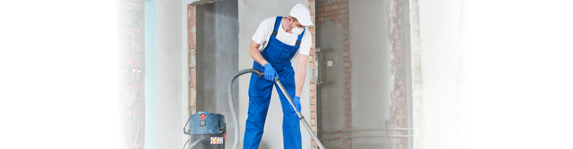 a utility person cleaning the building