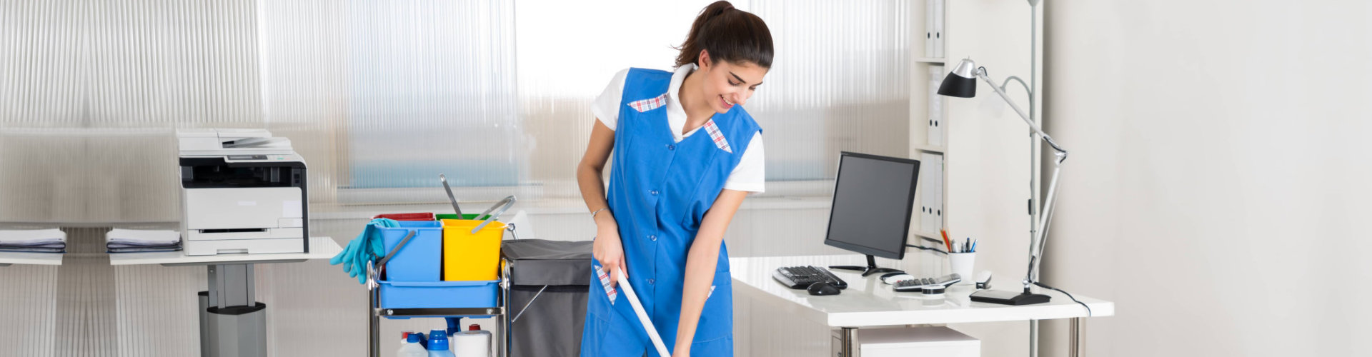a woman cleaning the room